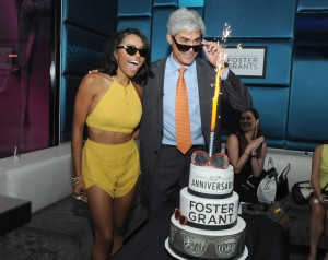 "The Vampire Diaries actress and musician Kat Graham and Foster Grant CEO Cesar Melo celebrate Foster Grant's 85th Anniversary,  Thursday, July 18, 2014, at Gansevoort Park Avenue in New York. Graham is the latest star to be featured in the brand's historic ""Who's that behind those Foster Grants?"" ad campaign. Foster Grant is credited with the birth of sunglasses in the United States, selling the first pair on the Atlantic City boardwalk for 10 cents in 1929. (Photo by Diane Bondareff/Invision for Foster Grant"