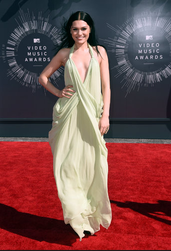 Jessie J in Vintage Halston, a real departure for her, the color and style look gorgeous.
